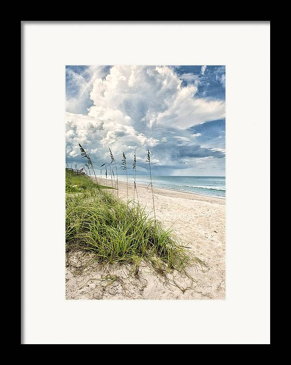 Clouds Framed Print featuring the photograph Clouds Over The Ocean by Cheryl Davis