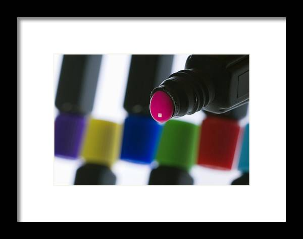Close-up Framed Print featuring the photograph Coloured Paint In A Bottle by Steve Horrell