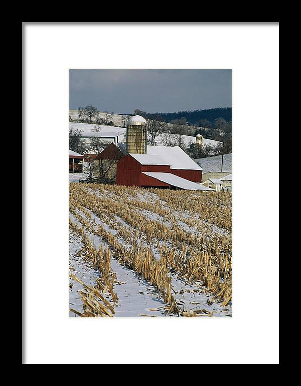 Scenes And Views Framed Print featuring the photograph Corn Stubble And Barn In A Wintery by Raymond Gehman