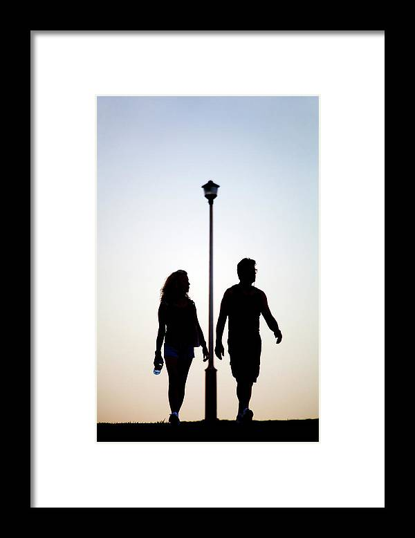 Adult Framed Print featuring the photograph Couple Exercise While Walking At Sunset by Virginia Star