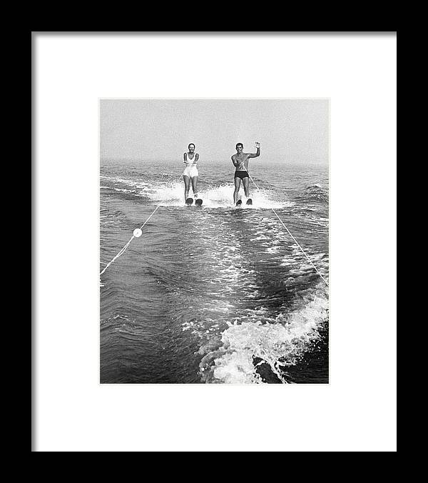 Adult Framed Print featuring the photograph Couple Water Skiing by George Marks
