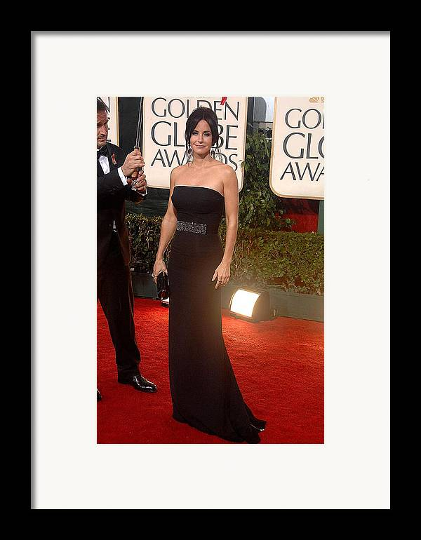 Courteney Cox Framed Print featuring the photograph Courteney Cox Wearing A Victoria by Everett