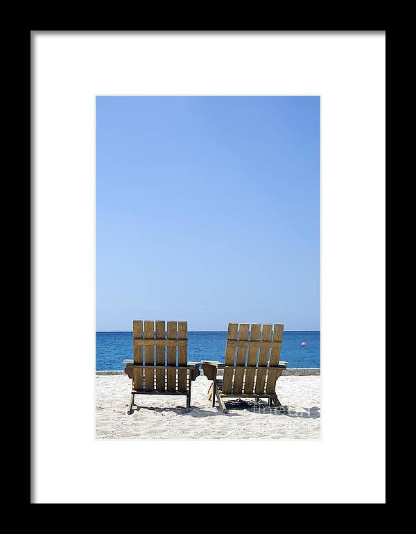 Travelpixpro Cozumel Framed Print featuring the photograph Cozumel Mexico Beach Chairs And Blue Skies by Shawn O'Brien