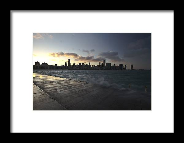 Framed Print featuring the photograph crashing waves at sunset in Chicago by Sven Brogren