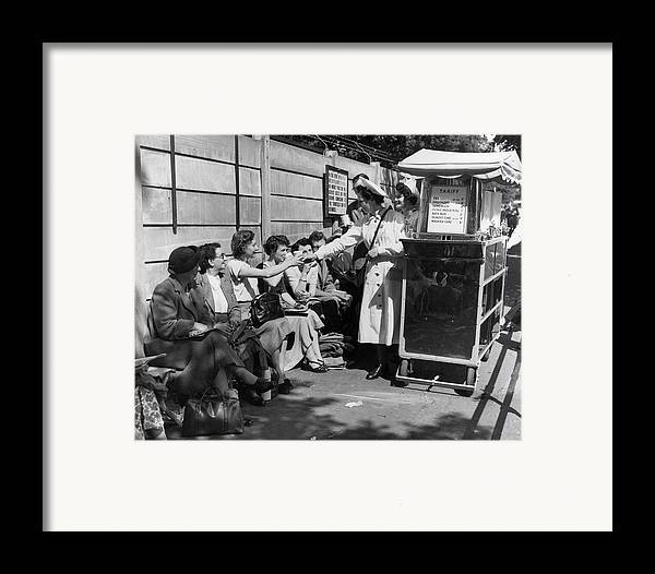 Mid Adult Framed Print featuring the photograph Crowd Refreshments by Central Press