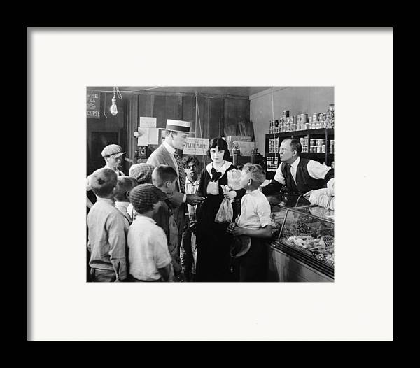 -ecq- Framed Print featuring the photograph Dangerous Talent, 1920 by Granger