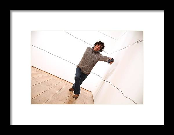 Jezcself Framed Print featuring the photograph Dave Climbs The Wall by Jez C Self