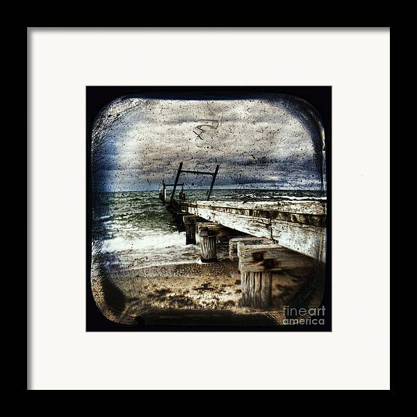 The Old Elwood Pier Framed Print featuring the photograph Deconstruction by Andrew Paranavitana