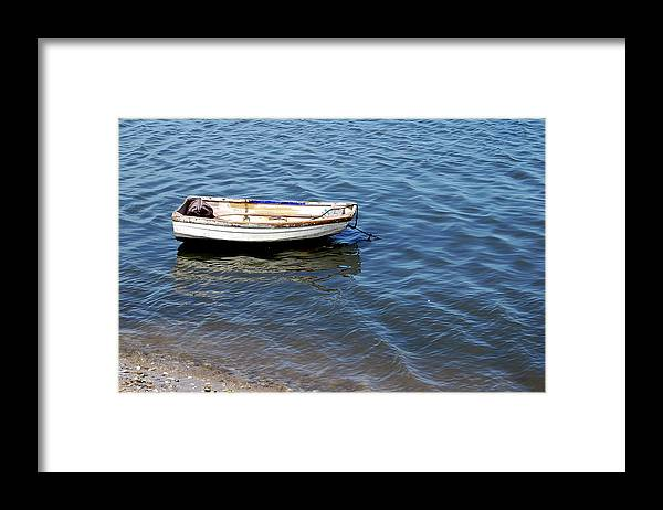 Dingy Framed Print featuring the photograph Dingy in St Augustine Bay by Jim and Kim Shivers