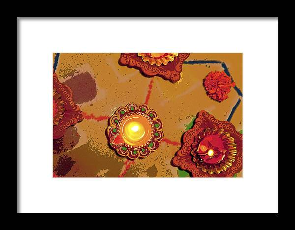 Interesting Framed Print featuring the photograph Diwali Colors By Candle by Kantilal Patel