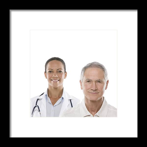 40-44 Years Framed Print featuring the photograph Doctor And Senior Man by