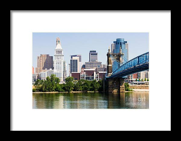 2012 Framed Print featuring the photograph Downtown Cincinnati Skyline And Roebling Bridge by Paul Velgos
