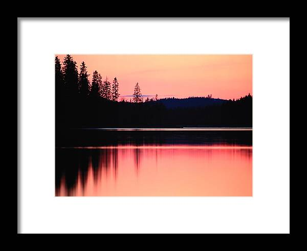 Scenic Views Framed Print featuring the photograph Dramatic Picture Of A Forest-edged Lake by Mattias Klum