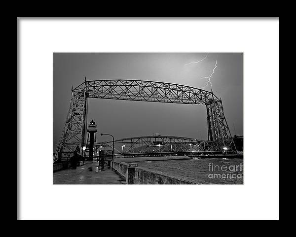 Lift Bridge Framed Print featuring the photograph Duluth Lift Bridge Under Lightning by Ever-Curious Photography