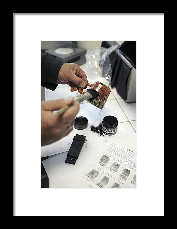 Forensic Framed Print featuring the photograph Dusting An Object For Fingerprints by Ria Novosti
