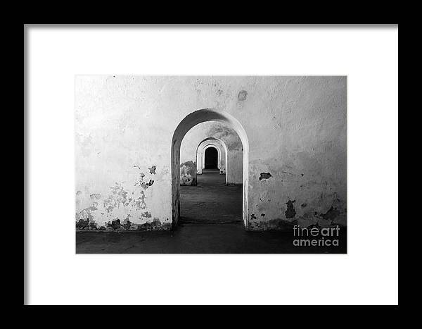Travelpixpro Puerto Rico Framed Print featuring the photograph El Morro Fort Barracks Arched Doorways San Juan Puerto Rico Prints Black And White by Shawn O'Brien
