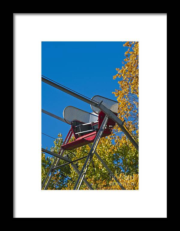 Amusement Framed Print featuring the photograph Empty Chair On Ferris Wheel by Thom Gourley/Flatbread Images, LLC
