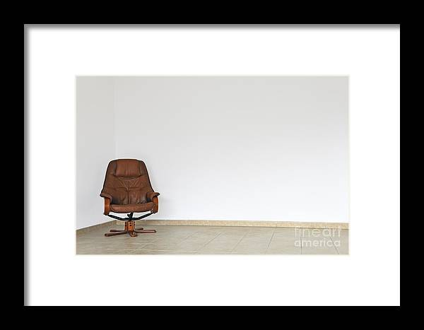 Empty Office Chair In Empty Room Framed Print by Sami Sarkis