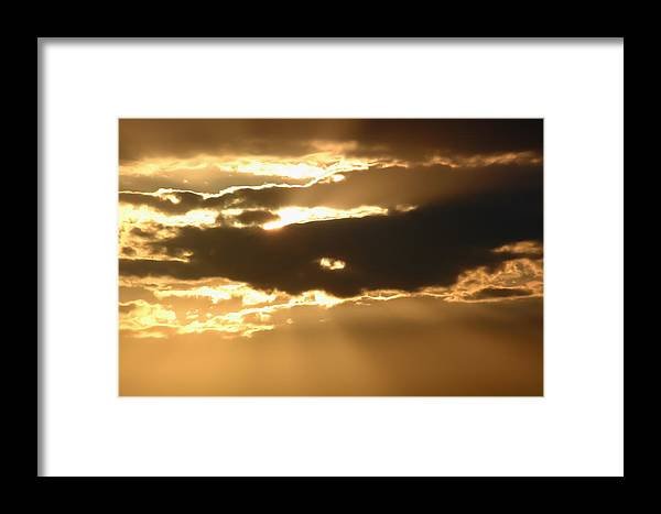 Clouds Framed Print featuring the photograph Evening Sun by Patrick M Lynch