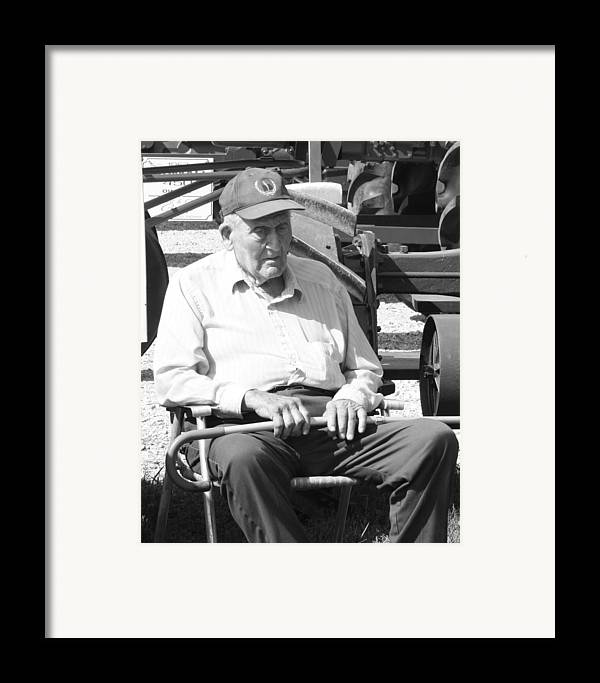 An Elderly Gentlemen Sitting By His Tracotr On A Hot Summer Day. Framed Print featuring the photograph Farmer by Ralph Hecht