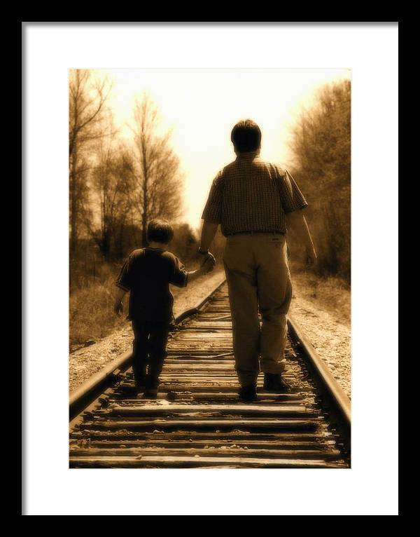 Father Framed Print featuring the photograph Father And Son by Bryan Davies