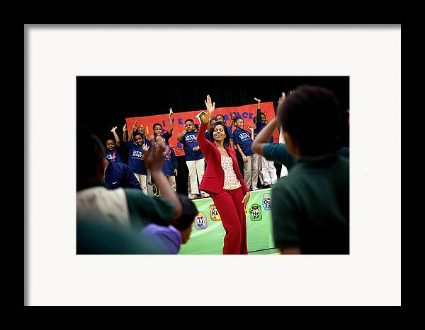 History Framed Print featuring the photograph First Lady Michelle Obama Exercises by Everett