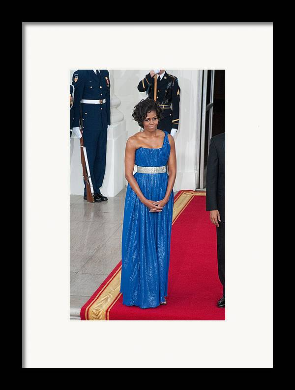 First Lady Michelle Obama Framed Print featuring the photograph First Lady Michelle Obama Wearing by Everett