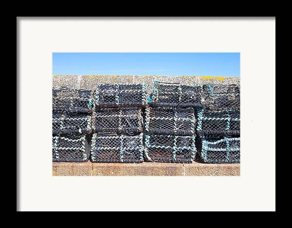 crab Nets Framed Print featuring the photograph Fishing Baskets by Tom Gowanlock