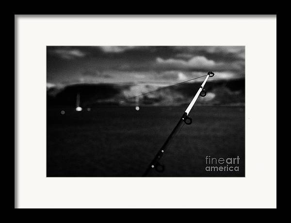 Fishing Framed Print featuring the photograph Fishing On The County Antrim Coast Northern Ireland by Joe Fox