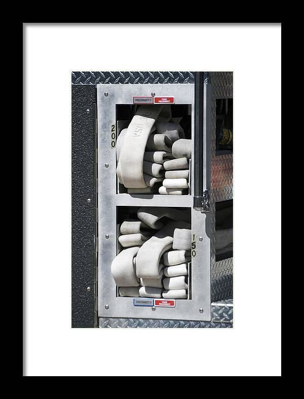 Featured Framed Print featuring the photograph Folded Fire Hose by Thomas Woolworth