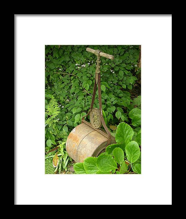 Tool Framed Print featuring the photograph Garden Roller by Tony Craddock