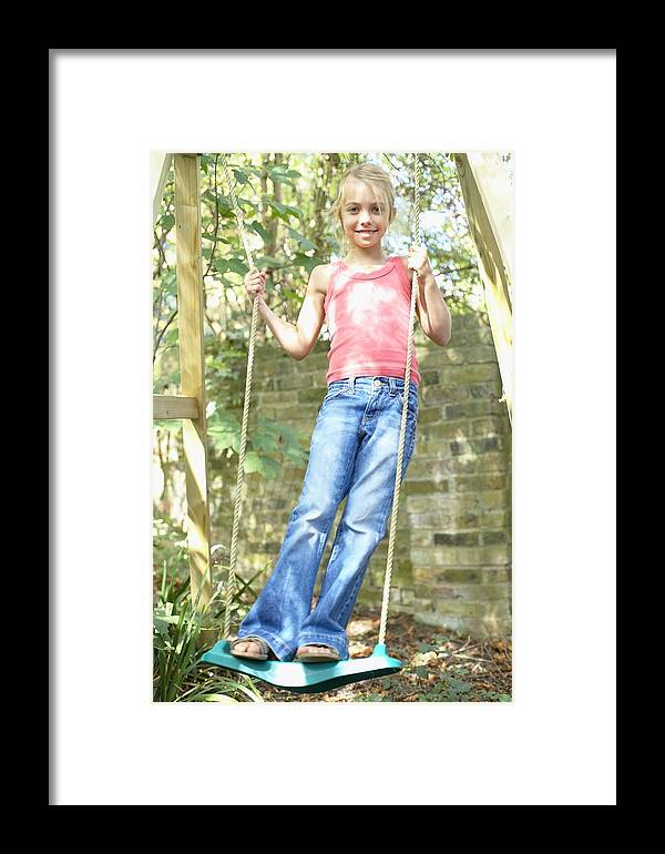Swing Framed Print featuring the photograph Girl Playing On A Swing by Ian Boddy