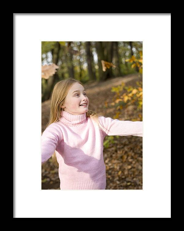 Human Framed Print featuring the photograph Girl Playing With Autumn Leaves by Ian Boddy