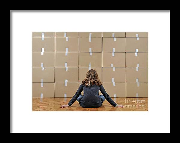 Facing Framed Print featuring the photograph Girl Seated In Front Of Cardboard Boxes by Sami Sarkis