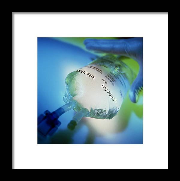 Iv Drip Framed Print featuring the photograph Gloved Hand Reaches For An Intravenous Drip Bag by Tek Image