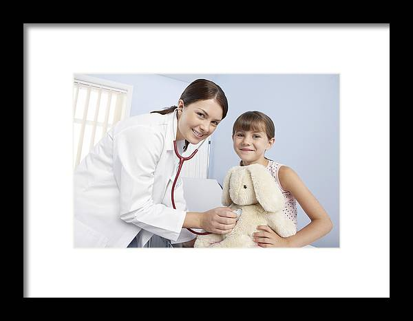 Stethoscope Framed Print featuring the photograph Gp And Child by Adam Gault
