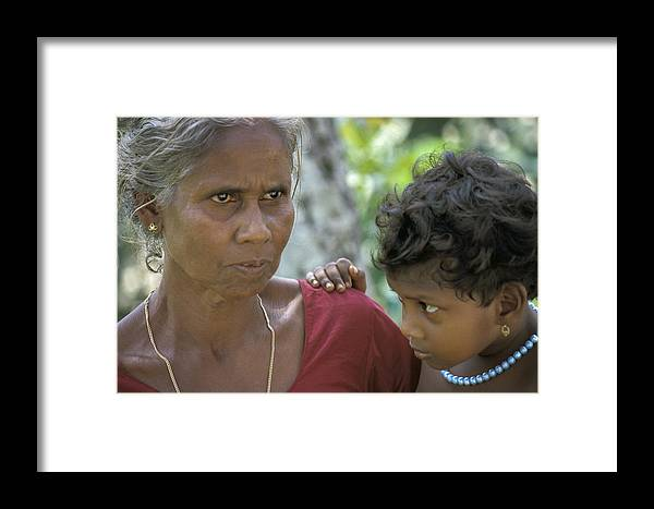 Book Framed Print featuring the photograph Grandmother And Child by Rudy Van Acker