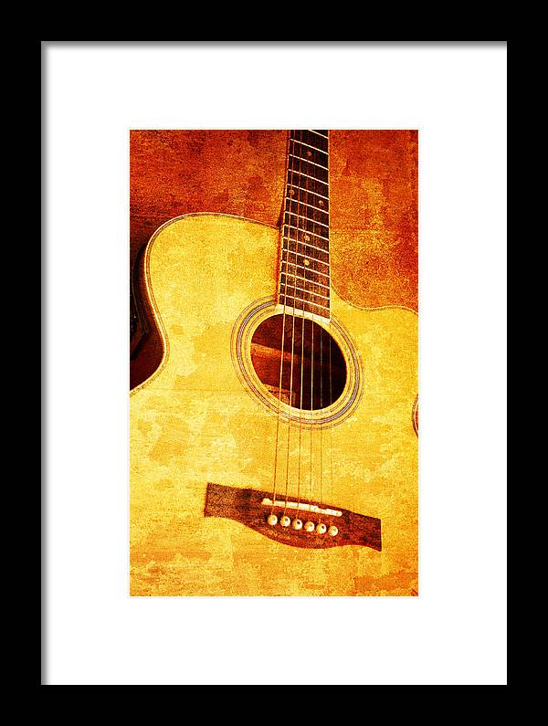 Aged Framed Print featuring the mixed media Guitar On Old Wall by Nattapon Wongwean