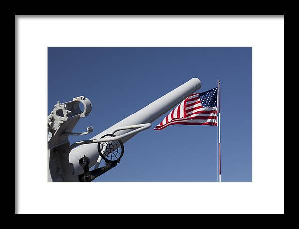 Old Naval Gun And The Flag At The Old Naval Training Center Framed Print featuring the photograph Guns And Glory by John Noel