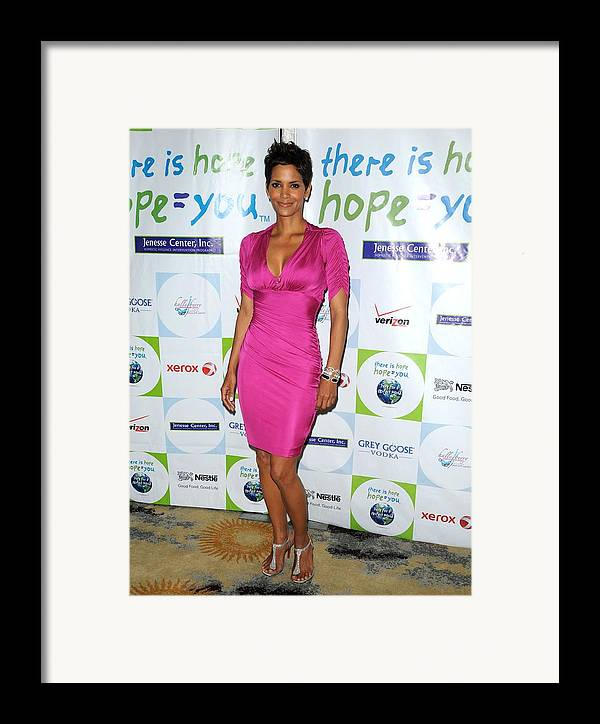 Halle Berry Framed Print featuring the photograph Halle Berry Wearing A Dress By Roberto by Everett