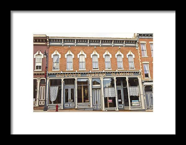 Framed Print featuring the photograph Hard Times In Central City by Larry Darnell