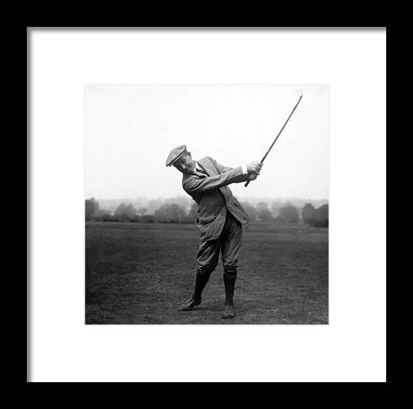 Harry Vardon Swinging His Golf Club Framed Print by International Images