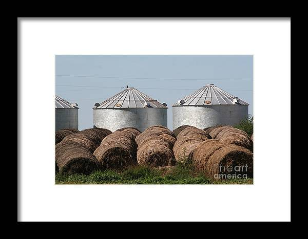 Hay Framed Print featuring the photograph Hay And Grain Bins by Roger Look