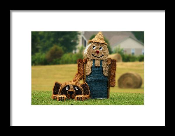 Hay Bale Framed Print featuring the photograph Hay Bale Farmer And Dog by Gene Berkenbile