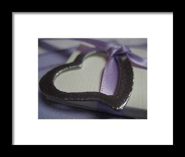 Heart Framed Print featuring the photograph Heart With Purple Ribbon by Carrie Munoz