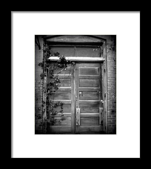 Black And White Framed Print featuring the photograph Hidden Door B And W by Lyndi Heckaman