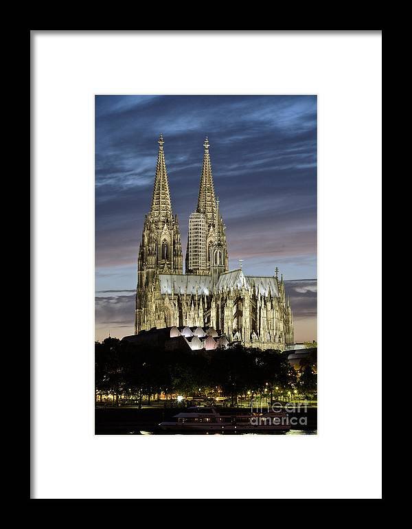 Cologne Cathedral Framed Print featuring the photograph High Cathedral Of Sts. Peter And Mary In Cologne by Heiko Koehrer-Wagner