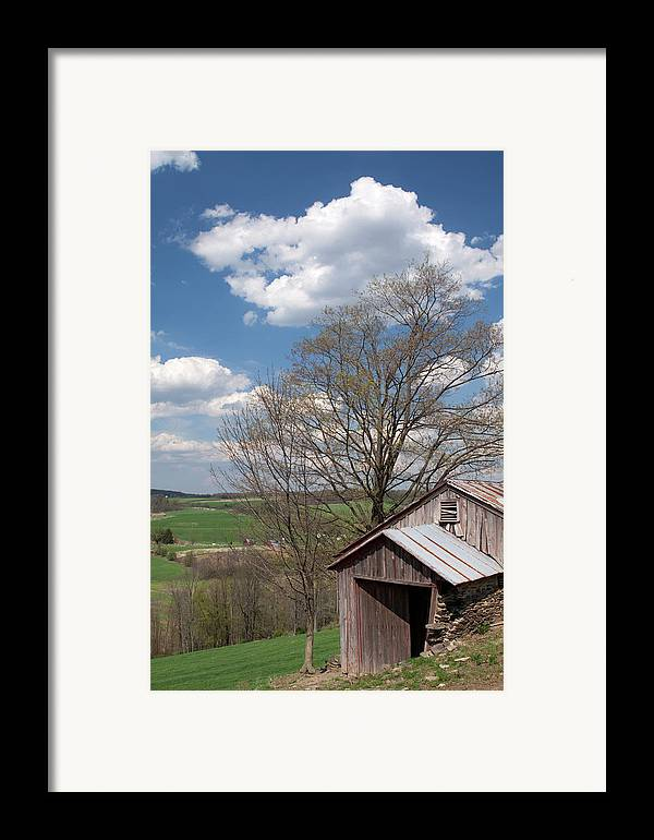 Tin Framed Print featuring the photograph Hillside Weathered Barn Dramatic Spring Sky by John Stephens