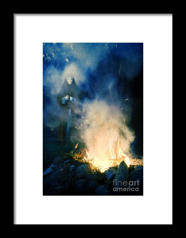 Fire Framed Print featuring the photograph Hooded Figure In A Mask By A Fire by Jill Battaglia