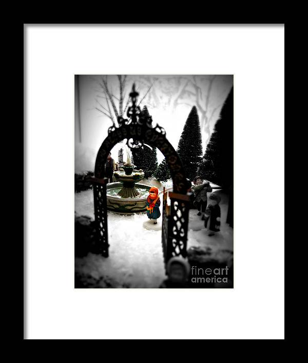 Dickens Framed Print featuring the photograph In the Village by Nancy Dole McGuigan